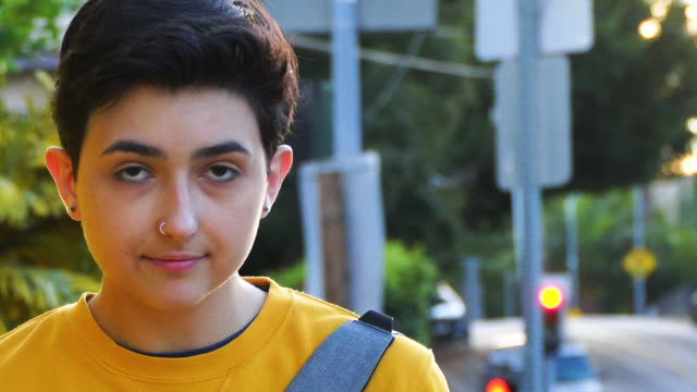 young woman in yellow sweatshirt strolling - shoulder bag stock videos & royalty-free footage