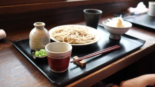 young woman in yukata pouring dashi broth to the cup - soba stock videos & royalty-free footage