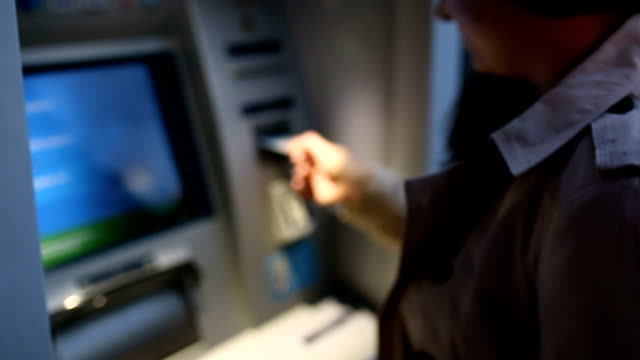 young woman inserting a credit card to atm - inserting stock videos & royalty-free footage