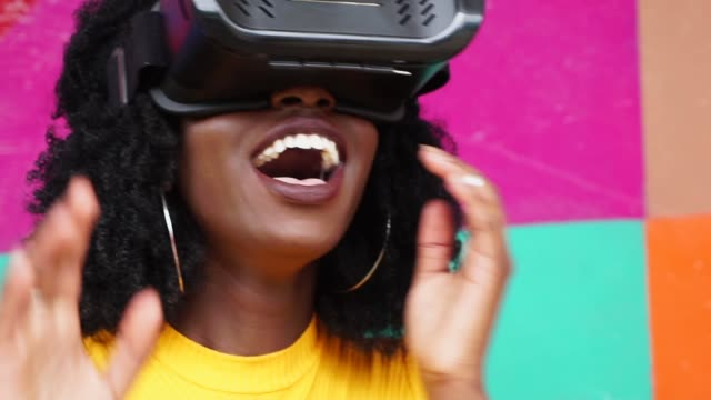 young woman interacting with vr - exploration stock videos & royalty-free footage