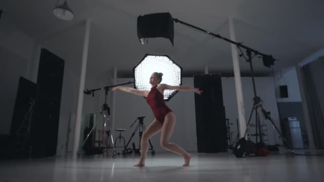 young woman is dancing in the studio - full length点の映像素材/bロール