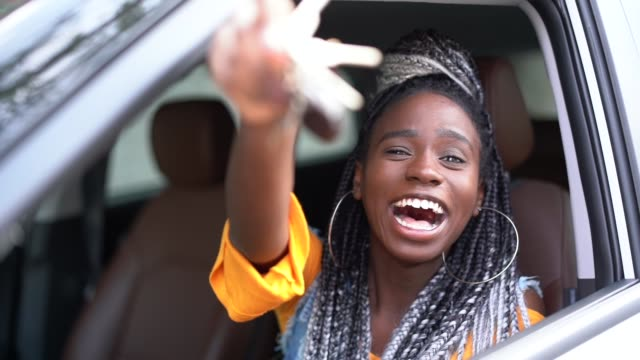 young woman is excited about new car - new stock videos & royalty-free footage