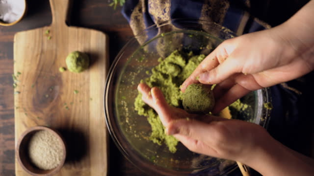 young woman is making homemade falafel - israel palestine conflict stock videos & royalty-free footage