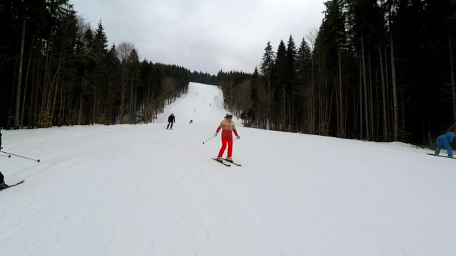 young woman is skiing at a ski resort. - real time stock videos & royalty-free footage
