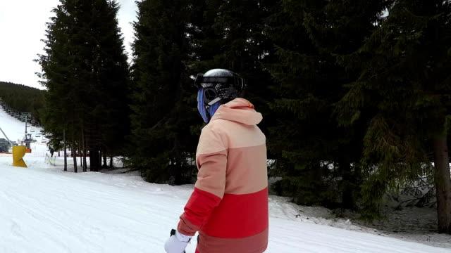young woman is skiing at a ski resort. - casco da motociclista video stock e b–roll