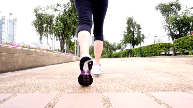 SLO MO Young woman Jogging in the park, Sport concept