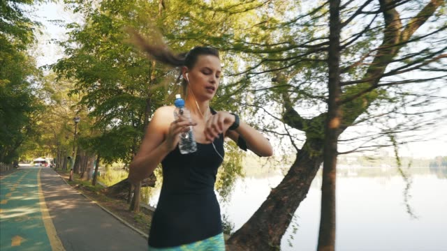 young woman jogging. - water bottle stock videos and b-roll footage