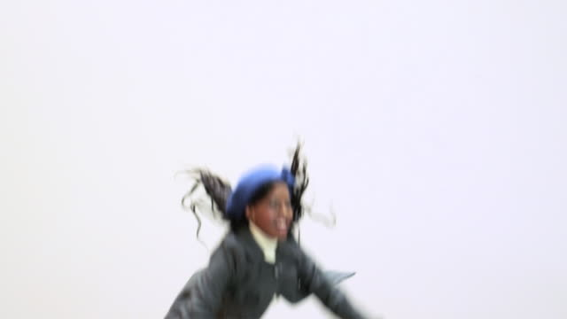 stockvideo's en b-roll-footage met young woman jumping, slow motion - trampoline