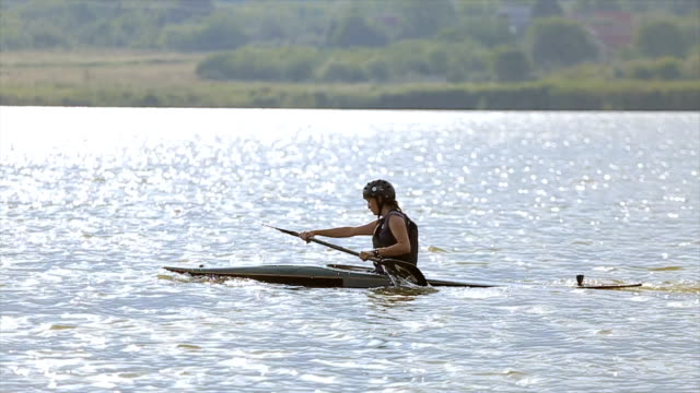 young woman kayaking - canoe stock videos & royalty-free footage