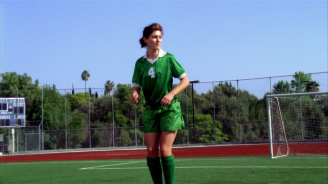 slo mo, ms, young woman kicking soccer ball and falling on field, biola university, la mirada, california, usa  - amateur stock videos & royalty-free footage