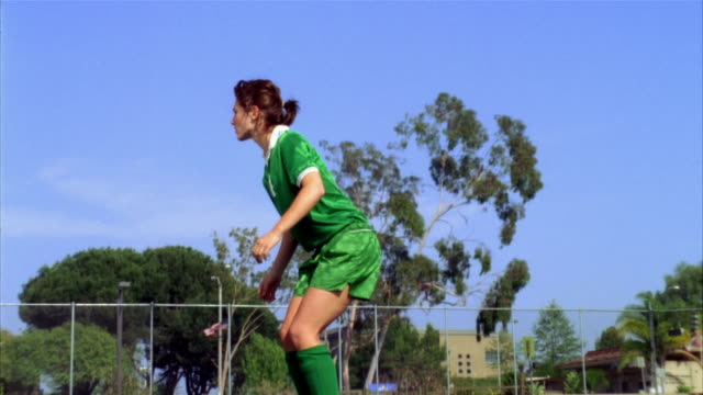 SLO MO, MS, Young woman kicking soccer ball and falling on field, Biola University, La Mirada, California, USA