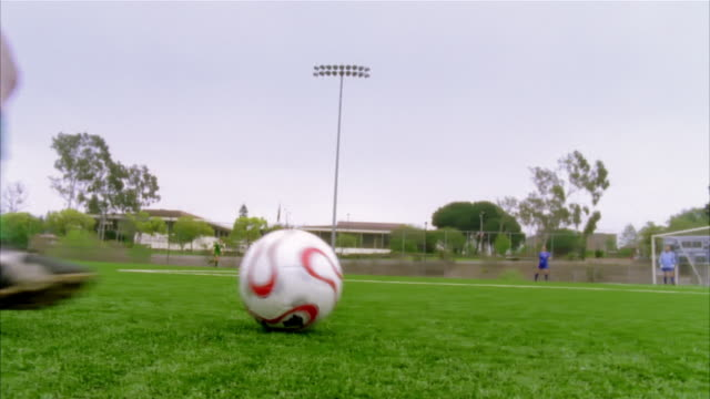 slo mo, cu,  young woman kicking soccer ball, low section, biola university, la mirada, california, usa  - amateur stock-videos und b-roll-filmmaterial