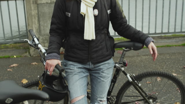 ms tu young woman leaning against bicycle / portland, oregon, usa - legs crossed at ankle stock videos & royalty-free footage