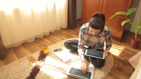 young woman learning at home. - multitasking stock videos & royalty-free footage