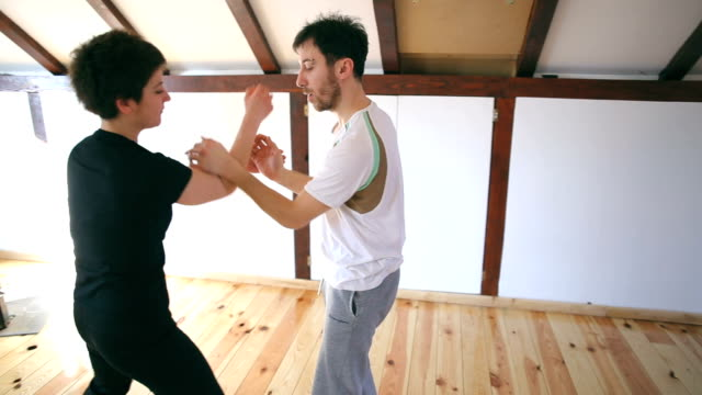 young woman learning to defend herself - self defence stock videos & royalty-free footage