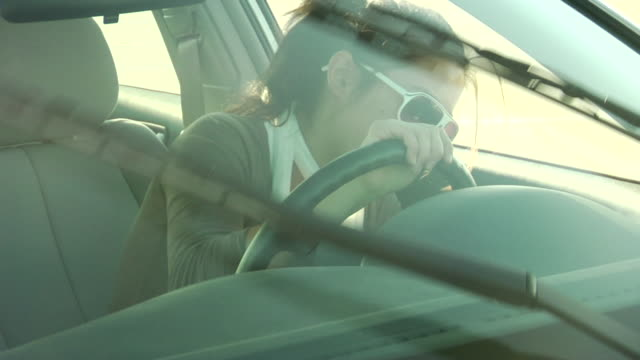 cu, young woman learning to drive, windshield wipers moving, jones beach, new york, usa - learning to drive stock videos and b-roll footage