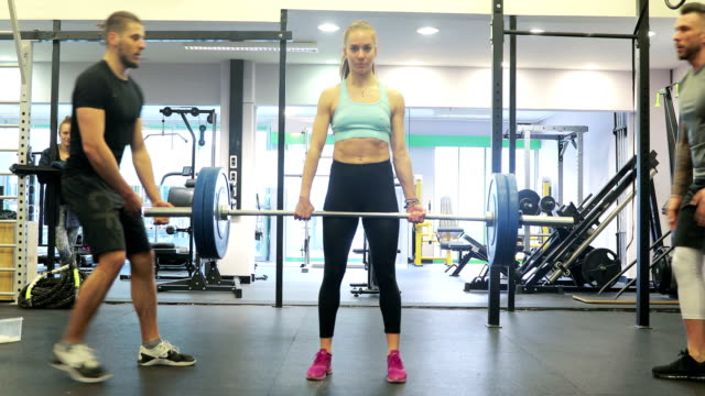 young woman lifting heavy weights in fitness - step aerobics stock videos and b-roll footage