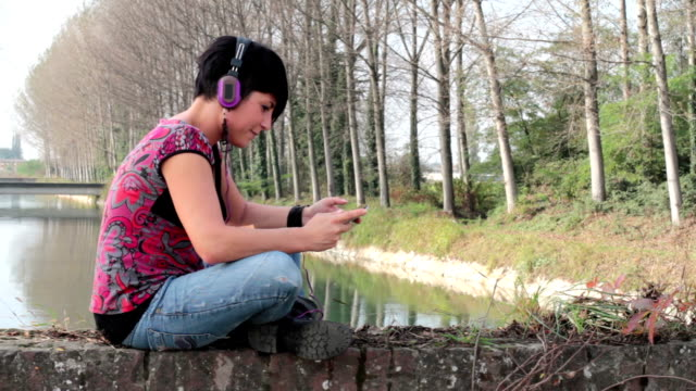 young woman listen music using headphones - pjphoto69 stock videos & royalty-free footage