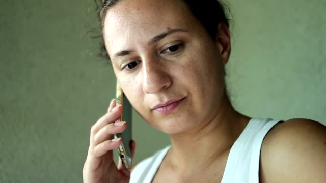 young woman listening to her mobile phone - waiting stock videos & royalty-free footage