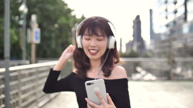 a young woman listening to music - only japanese stock videos & royalty-free footage