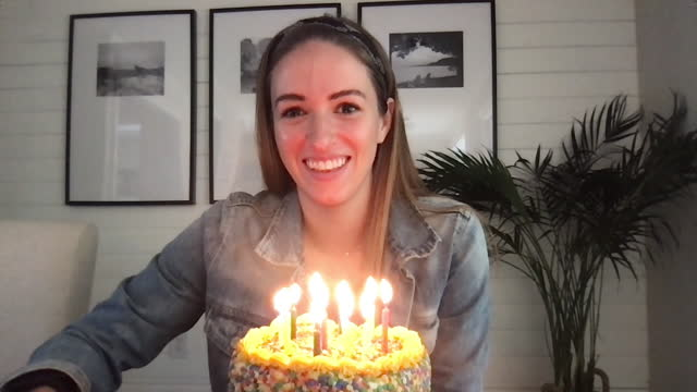 a young woman listens to her friends as they sing her happy birthday - birthday stock videos & royalty-free footage