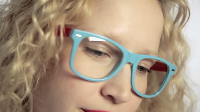 young woman looking around and looking over glasses - sideways glance stock videos & royalty-free footage