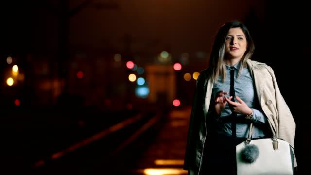 Young woman looking at camera and talking
