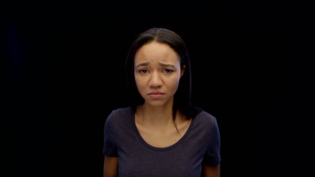 young woman looking at imaginary, depressing view - colore isolato video stock e b–roll