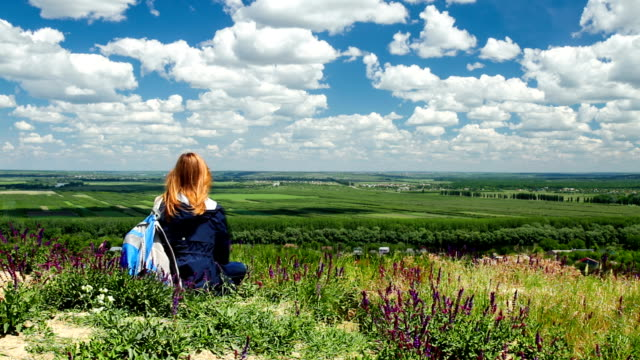 Young woman looking at scenic view of valley