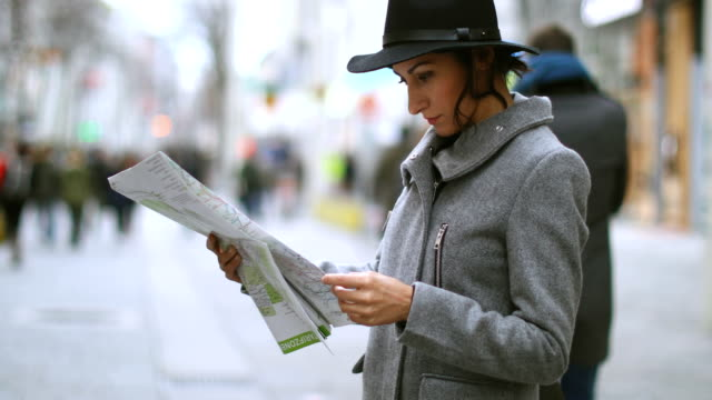 young woman looking at the map in vienna - road map stock videos & royalty-free footage