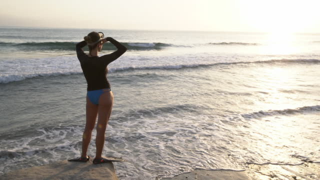 WS Young woman looking at the sunset wearing snorkeling gear