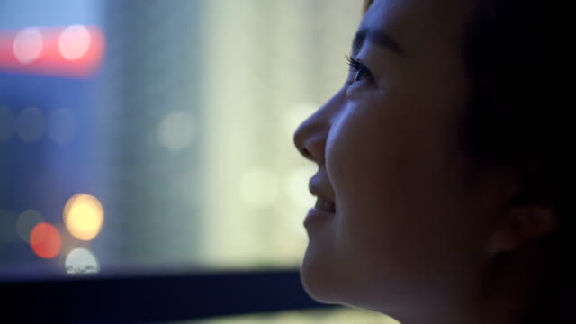 young woman looking out of a window - looking at view stock videos & royalty-free footage