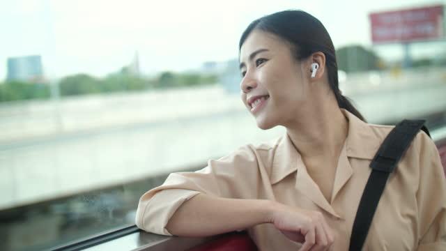 young woman looking out of the window on the train - människokroppsdel bildbanksvideor och videomaterial från bakom kulisserna