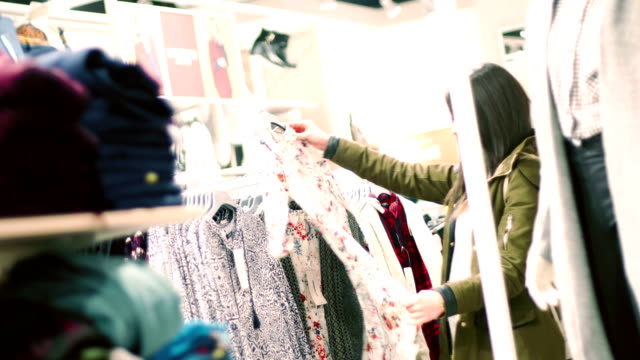 young woman looking through clothes - matching outfits stock videos & royalty-free footage