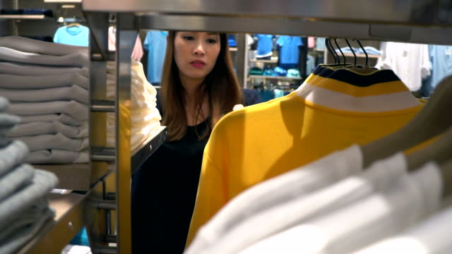 Young woman looking through clothes