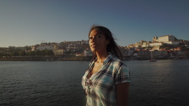 young woman looks around her - porto, portugal - porto district portugal stock videos & royalty-free footage