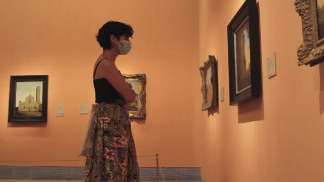 young woman looks at one of the exhibition rooms at the thyssen-bornemisza national museum on june 6 in madrid, spain. today, the museum reopened to... - one young woman only stock videos & royalty-free footage