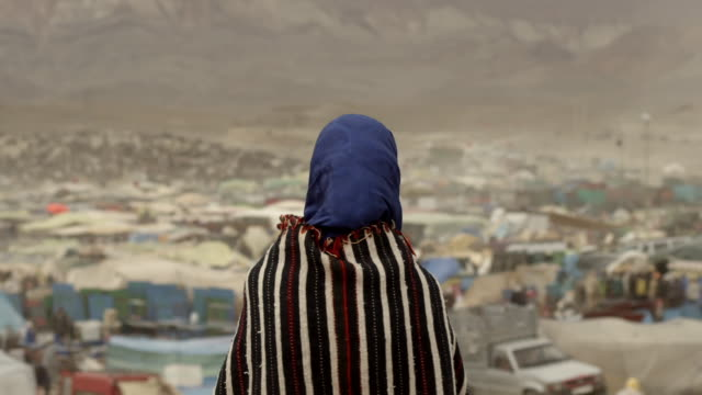 young woman looks out over festival, atlas mountains - obscured face stock videos & royalty-free footage