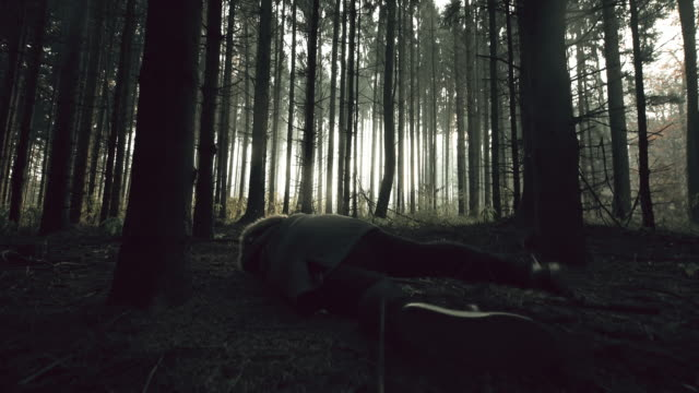 young woman losing consciousness in the forest - nausea stock videos & royalty-free footage