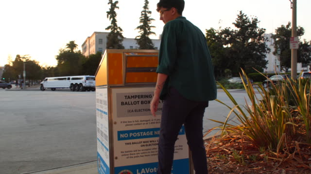 young woman mailing her ballot at the official pasadean ballot drop box - ballot box stock videos & royalty-free footage