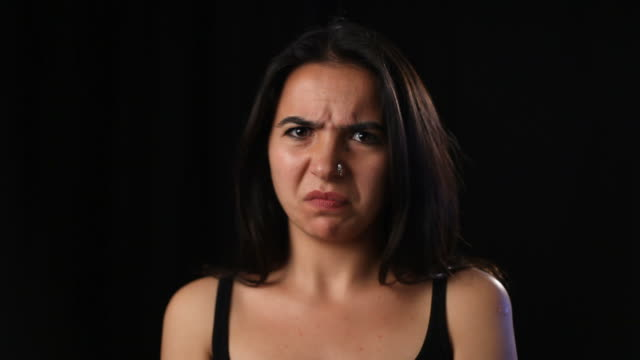 young woman making a grimace - grimacing stock videos & royalty-free footage