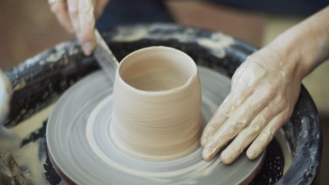 young woman making ceramics in her pottery workshop, small business concept - potter stock videos & royalty-free footage