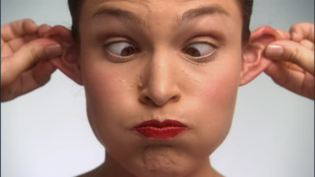slo mo, cu, young woman making funny faces, portrait - grimacing stock videos & royalty-free footage