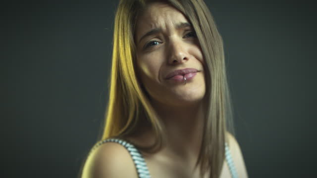 young woman making funny faces - acting stock videos & royalty-free footage