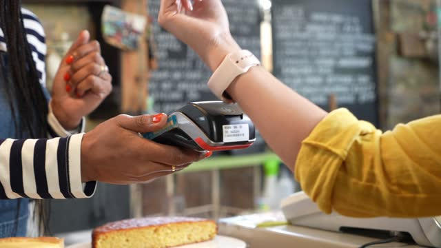 young woman making payment with smart watch - wrist watch stock videos & royalty-free footage