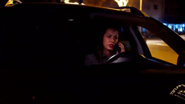 young woman making phone call in car - rolling eyes stock videos & royalty-free footage