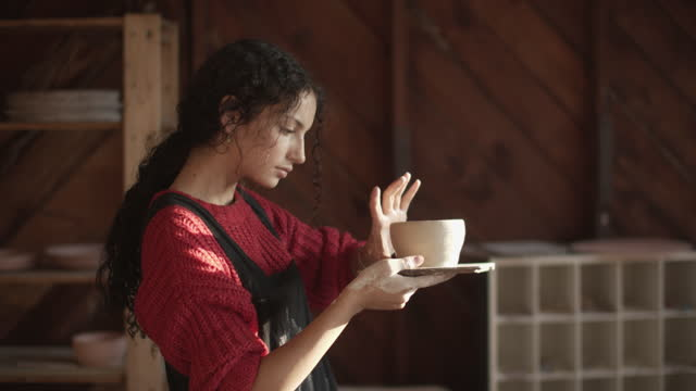cu young woman making pottery in her studio - young women stock videos & royalty-free footage