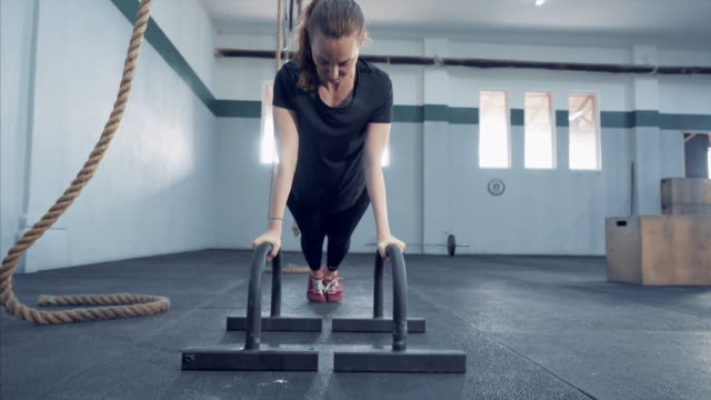 young woman making pushups in gym. - pilates stock videos and b-roll footage