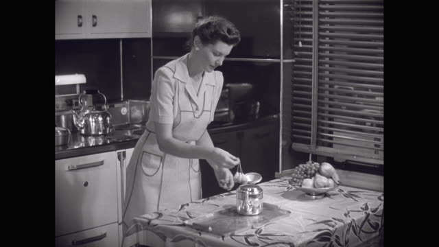 MS Young woman making tea in kitchen / United States