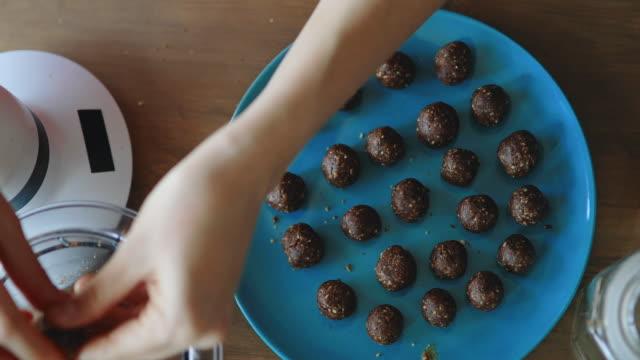 young woman making vegan raw sweet bits - raw food stock videos & royalty-free footage